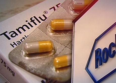 Förpackning Tamiflu och kapslar