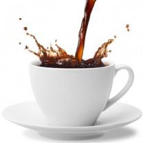 Vit kopp med kaffe