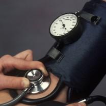 Arm och blodtrycksmätare