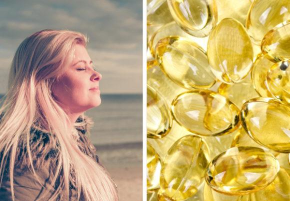 kvinna solar d-vitaminkapslar