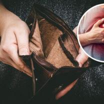 tom plånbok hnågon som håller sig för hjärtat