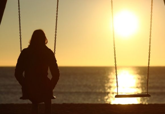 lonely-woman-watching-sunset-alone-in-winter-picture-id493659014 (1)