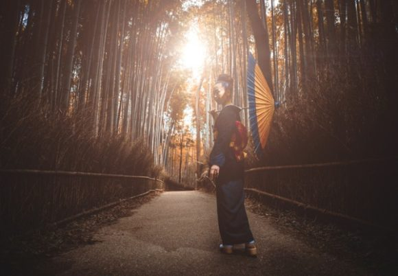 beautiful-japanese-senior-woman-walking-in-the-bamboo-forest-picture-id914969520 (1)