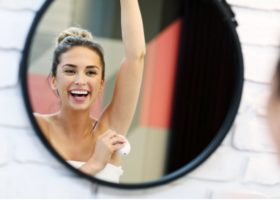 young-woman-using-deodorant-in-bathroom-picture-id1066628704 (3)